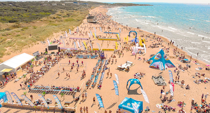 Aerial view of Tylösand beach with volleyball match on