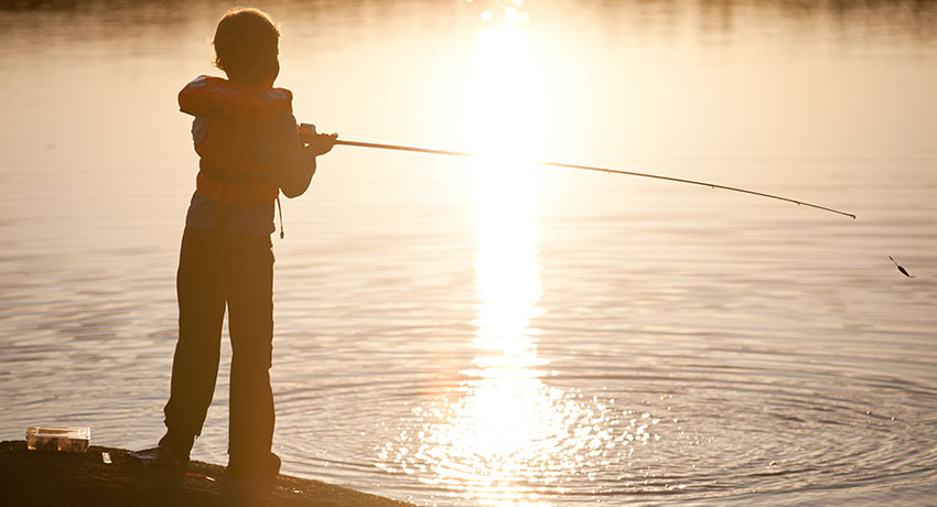 Children fish in backlight
