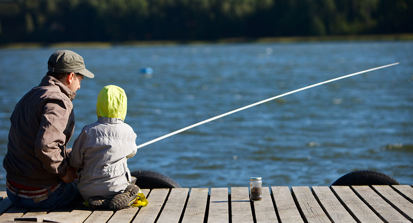 Adult and child fishing from a pier in Halmstad