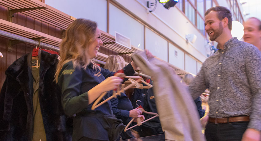 Guest hangs jackets in wardrobe at Halmstads Teater